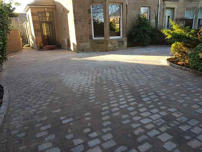 After photo of the driveway in Glasgow with their new Momoblock Driveway with edges and drainage stank. Newlands Road