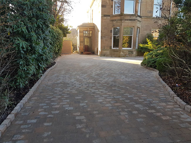 After photo of the driveway in Glasgow with their new Momoblock Driveway with edges and drainage stank