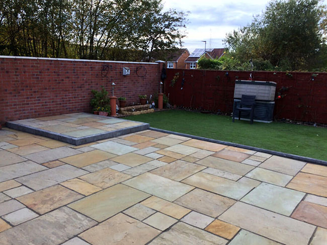 Garden patio with landscaping & artificial grass