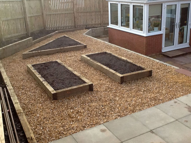 Timber sleeper planters decorative-chips Indian sandstone paving